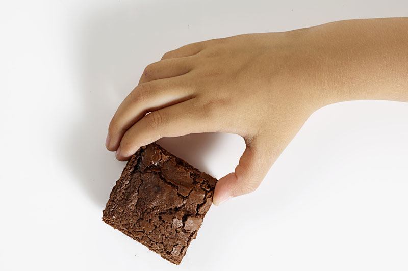 Boy holding brownie square