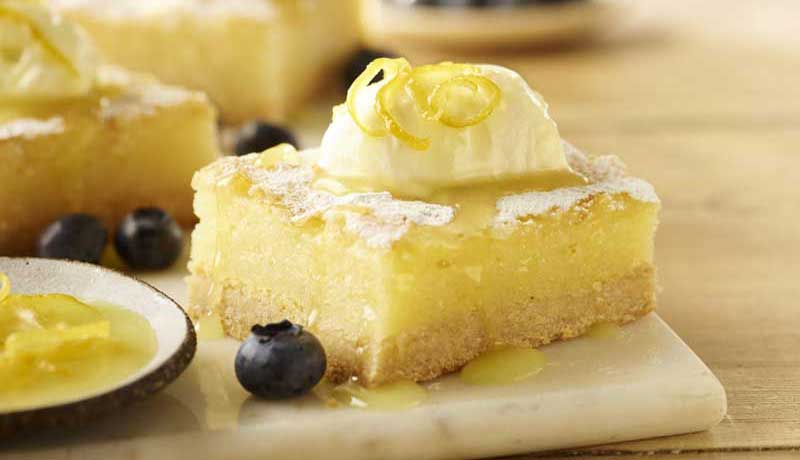Lemon Bars with Cream and Blueberries